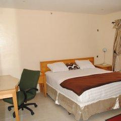 Mikagn Hotel and Suites Ибадан комната для гостей