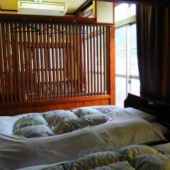 Отель Sudomari Minshuku Friend Якусима комната для гостей фото 5
