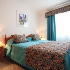 Отель Viviendas Vacacionales Marcial комната для гостей