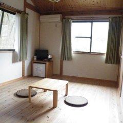Отель Iyashi no Minshuku Tonton Якусима комната для гостей фото 2