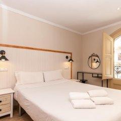 Апартаменты Charming Apartment In Barcelona Center Барселона комната для гостей фото 4
