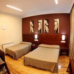 Отель Hostal Abadia Стандартный номер с 2 отдельными кроватями фото 8