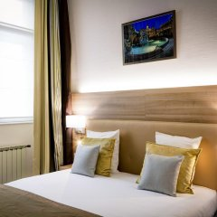 Отель Le Phénix Hôtel Франция, Лион - отзывы, цены и фото номеров - забронировать отель Le Phénix Hôtel онлайн удобства в номере фото 2