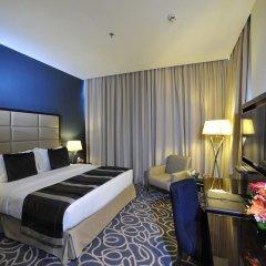 Отель Ramada Corniche 4* Номер Делюкс фото 9
