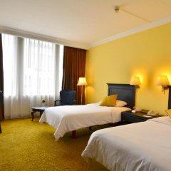 Отель The Tawana Bangkok 3* Улучшенный номер с разными типами кроватей фото 4