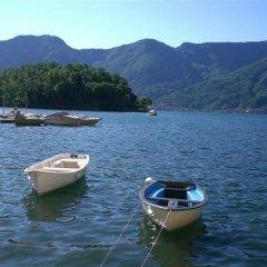 Отель Imelde Sul Lago Меззегра приотельная территория