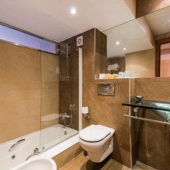 Отель Astuy Apartamentos Арнуэро ванная