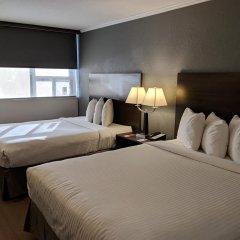 Отель Econo Lodge South Calgary Канада, Калгари - отзывы, цены и фото номеров - забронировать отель Econo Lodge South Calgary онлайн комната для гостей фото 3