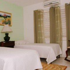 Отель Mango Tree Peaceful Pension комната для гостей фото 2