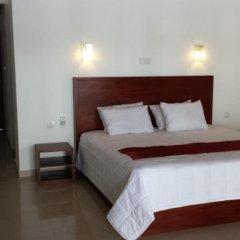 Отель Whispering Palms Hotel Шри-Ланка, Бентота - отзывы, цены и фото номеров - забронировать отель Whispering Palms Hotel онлайн комната для гостей фото 5
