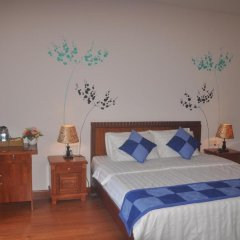 Отель Tra Que Riverside Homestay 2* Улучшенный номер с различными типами кроватей фото 8