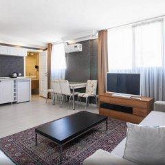 Отель Defne Suites Улучшенные апартаменты с различными типами кроватей фото 28