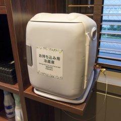 Отель Anshin Oyado Premier Shinbashi Shiodome 2* Капсула в мужском общем номере фото 6