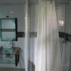 Отель Axari Hotel & Suites Нигерия, Калабар - отзывы, цены и фото номеров - забронировать отель Axari Hotel & Suites онлайн ванная