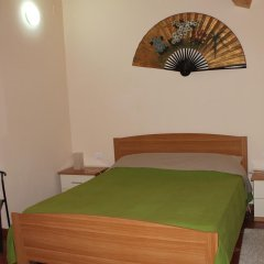 Отель Palazzo Croce 1 Рокка-Сан-Джованни комната для гостей фото 2