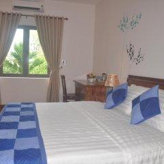 Отель Tra Que Riverside Homestay 2* Улучшенный номер с различными типами кроватей фото 9