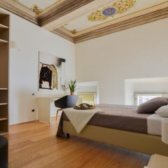 Отель Palazzo Banchi Halldis Apartments Италия, Болонья - отзывы, цены и фото номеров - забронировать отель Palazzo Banchi Halldis Apartments онлайн удобства в номере фото 2