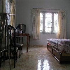 Отель Ms. Yang Homestay Стандартный семейный номер с двуспальной кроватью фото 3