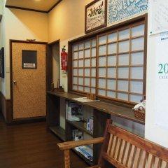 Отель Sudomari Minshuku Friend 2* Кровать в мужском общем номере фото 4