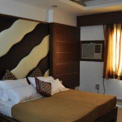 Отель Sarthak Palace Индия, Нью-Дели - отзывы, цены и фото номеров - забронировать отель Sarthak Palace онлайн сейф в номере