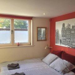 Отель Houseboat Westerdok Нидерланды, Амстердам - отзывы, цены и фото номеров - забронировать отель Houseboat Westerdok онлайн комната для гостей фото 2