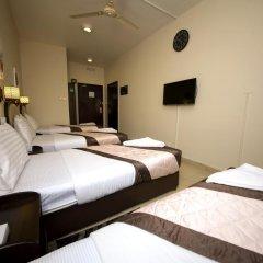 Grand Sina Hotel Стандартный семейный номер с различными типами кроватей фото 7