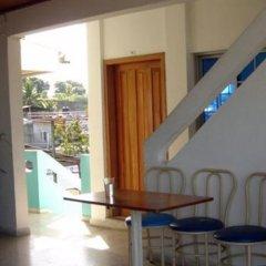 Отель Ejecutivos ApartHotel Гондурас, Тела - отзывы, цены и фото номеров - забронировать отель Ejecutivos ApartHotel онлайн интерьер отеля