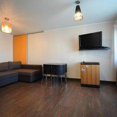 Апартаменты на Республики 86 Тюмень комната для гостей фото 4