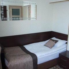 Мини-Отель Каприз Стандартный номер разные типы кроватей фото 21
