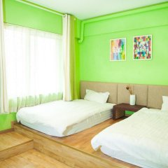 Slow City Youth Hostel комната для гостей