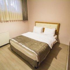 Апартаменты Feyza Apartments Семейные апартаменты с двуспальной кроватью фото 24