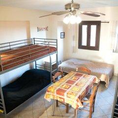 Отель Studios Arabas Кровать в общем номере с двухъярусной кроватью фото 4