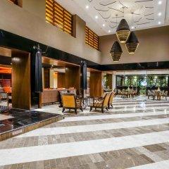 Отель Omni Cancun Hotel & Villas - Все включено Мексика, Канкун - 1 отзыв об отеле, цены и фото номеров - забронировать отель Omni Cancun Hotel & Villas - Все включено онлайн интерьер отеля фото 2