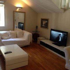 Апартаменты London Apartment комната для гостей фото 3