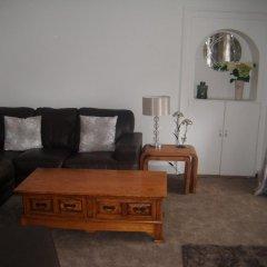 Апартаменты The Village Inn Apartment комната для гостей фото 4
