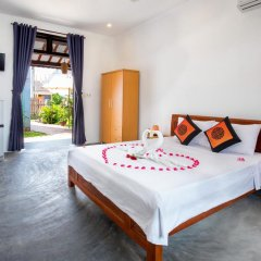 Отель An Bang Sunrise Beach Bungalow комната для гостей фото 3