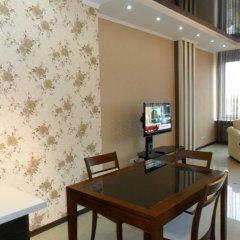 Апартаменты Arcadia City Apartments комната для гостей