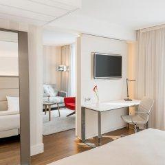 Отель NH Collection Berlin Mitte Am Checkpoint Charlie 4* Улучшенный номер с двуспальной кроватью фото 2