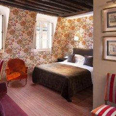 Отель Hôtel Saint Paul Rive Gauche 4* Стандартный семейный номер с двуспальной кроватью