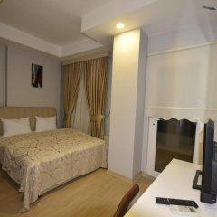 Tugra Hotel Номер Делюкс с различными типами кроватей фото 2