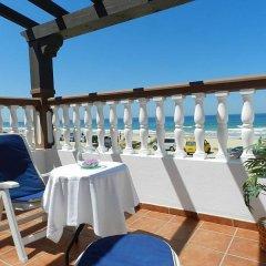 Отель Hostal El Alferez Испания, Вехер-де-ла-Фронтера - отзывы, цены и фото номеров - забронировать отель Hostal El Alferez онлайн балкон