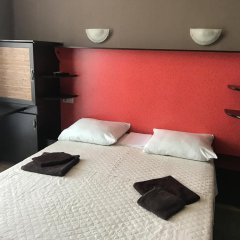 Апартаменты Svetlana Apartments Сочи комната для гостей фото 2