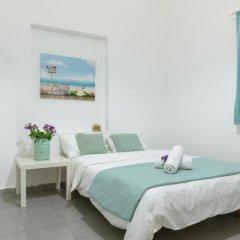 Апартаменты Hacarmel Apartment Тель-Авив комната для гостей фото 5