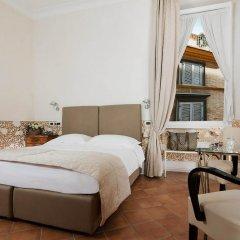 Отель Caesar House Residenze Romane 3* Стандартный номер с двуспальной кроватью фото 2
