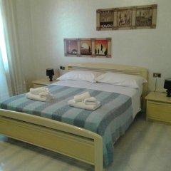 Отель Case Vacanze Lido Sacramento Италия, Сиракуза - отзывы, цены и фото номеров - забронировать отель Case Vacanze Lido Sacramento онлайн комната для гостей фото 5
