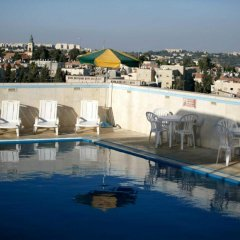 Отель Caesar Premier Jerusalem Иерусалим бассейн фото 3