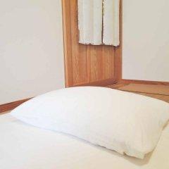 Отель Iyashi no Minshuku Tonton Якусима комната для гостей фото 4