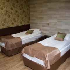 Мини-Отель Каприз комната для гостей фото 3