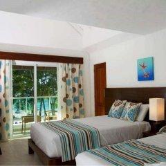 Отель Grand Paradise Playa Dorada - All Inclusive 3* Улучшенный номер с различными типами кроватей фото 2