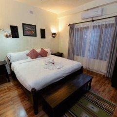 Отель Mingtang Garden Cottage 名堂花园度假屋 Непал, Покхара - отзывы, цены и фото номеров - забронировать отель Mingtang Garden Cottage 名堂花园度假屋 онлайн комната для гостей фото 2
